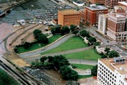 Aerial view of Dealey Plaza in Dallas Texas. Texas School Book Depository building is at center-top. The 'grassy knoll' is down and left from there. Courtesy Stewart Galanor.