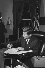 President Kennedy signing the declaration of quarantine during the Cuban Missile Crisis, 23 Oct 1962.